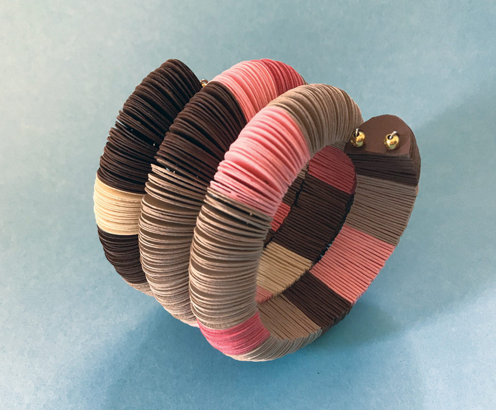 colorful paper bracelet in the shape of a snake